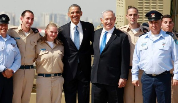 U.S. President Barack Obama poses with Israeli defense personnel as he views an Iron Dome battery with Prime Minister Benjamin Netanyahu at Ben Gurion International Airport, March 20, 2013.Photo by Reuters
